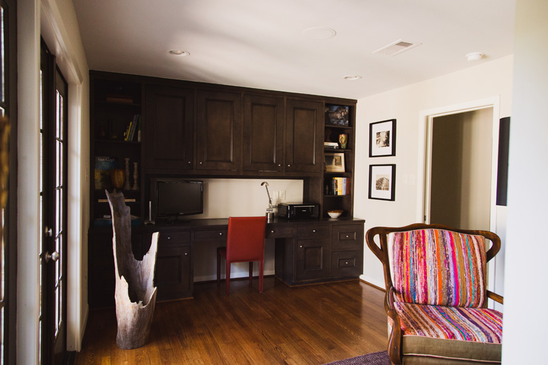 Gorgeous built-in cabinets in the office area provide tons of storage.