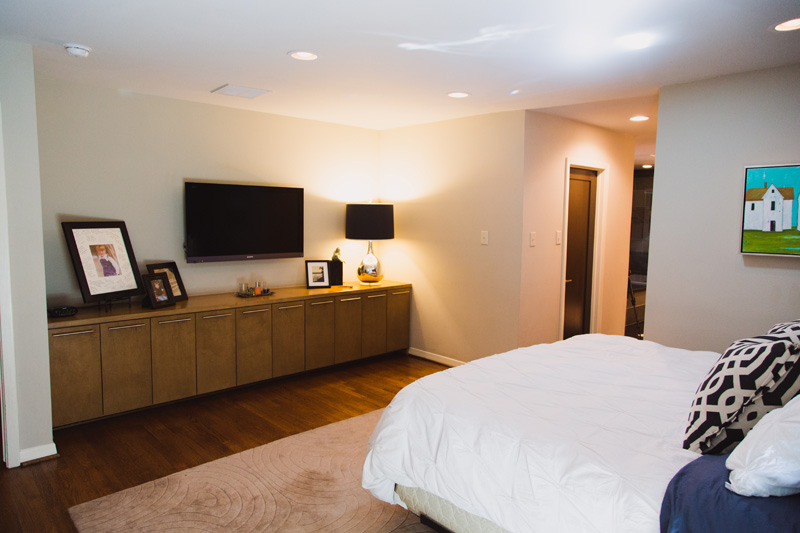 Master bedroom with with built-in cabinets. The room also has two walk-in closets with phenomenal storage.